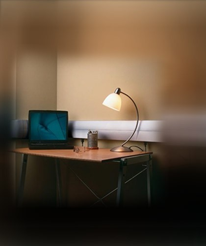 Computer & lamp connected to an outlet on surface raceway