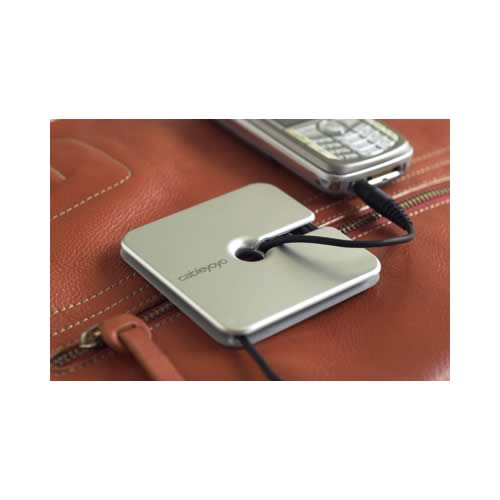 silver cable yoyo cable organizer in use with cell phone charger - icon
