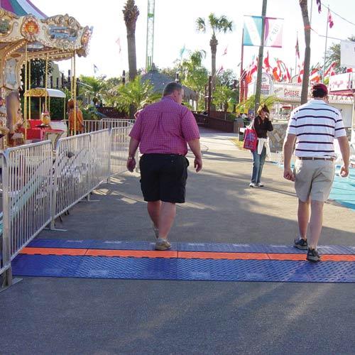 ada compliant cord protectors at a festival
