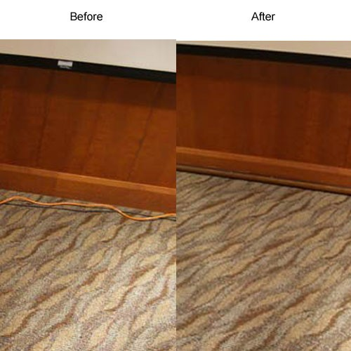 decorative cord protector in use along baseboard