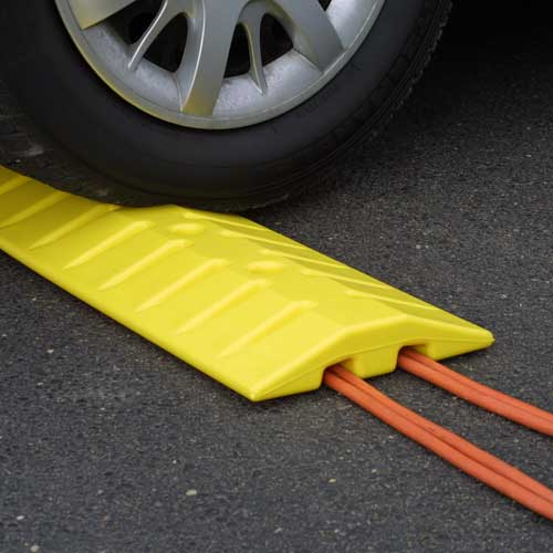 yellow speed bump cable protector in use - icon