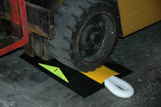 furrion portable cable protector and hose ramp in use under a fork lift icon