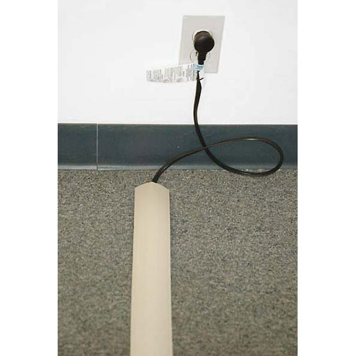 beige power extension in use on carpet icon