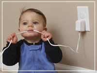 baby chewing on cable