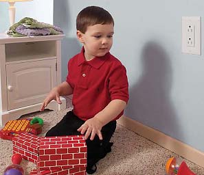 child in playroom by outlet