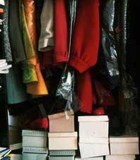 shoe boxes in a clothes closet