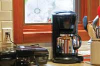 coffee maker and sandwich press in kitchen