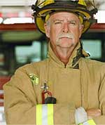 firefighter with arms crossed