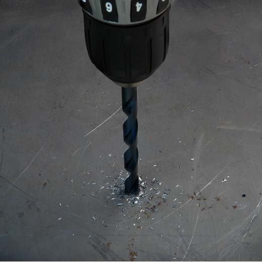 Milwaukee Thunderbolt Black Oxide Drill Bit in use on metal icon