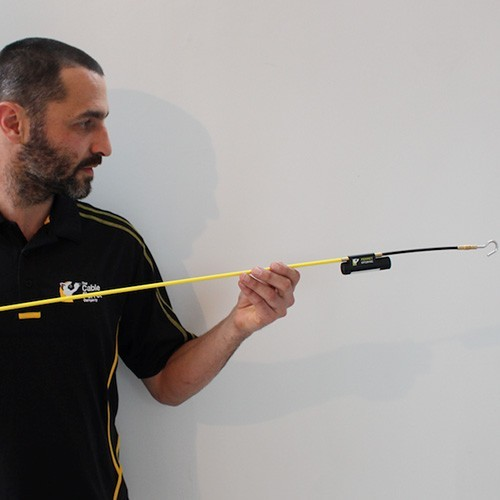 cable ferret connected to a finishing rod