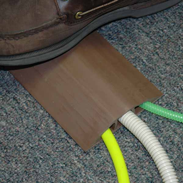electriduct brown ed-cp-d-2 rubber cable protector in use with foot traffic - icon