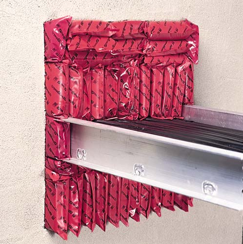 Specified Technology STI SpecSeal Firestop Pillows installed around cable tray - icon