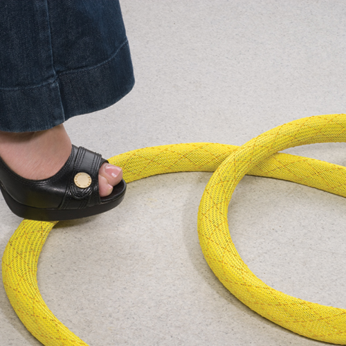 yellow Non-Skid Slip Resistant Expandable Braided Sleeving being stepped on - icon