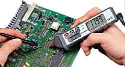 Using a multimeter on a circuit board